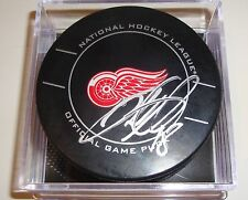 Ian White Signed Puck w/COA Detroit Red Wings Official Game Puck