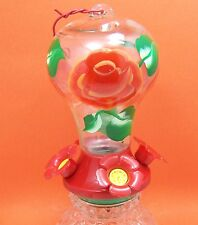 Glass flowered humming bird feeder with flowers