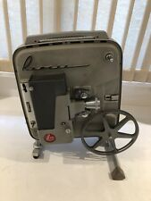 VINTAGE REVERE 8MM PROJECTOR 777 WITH BUILT IN CASE,REEL,AC CORD&NEW BULB TESTED