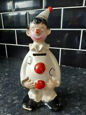 Ellgreave clown Go-Go money box with stopper 10 1/2 inch x 4 1/2 wide