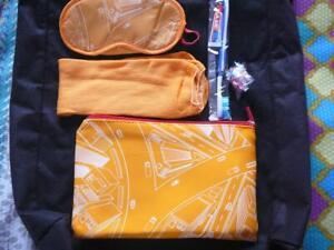 TRAVEL PACKS:TOOTHBRUSH, PASTE, EYE MASK, EAR PLUGS, SOCKS  in easy carry bag