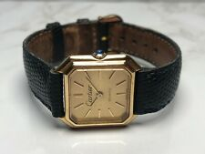 VINTAGE 18kt GOLD LADIES CARTIER AUTOMATIC WATCH BY BAUME MERCIER.