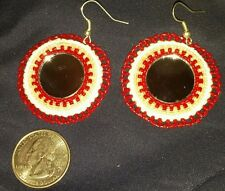 Women's beaded red and white earrings with mirrors in the center