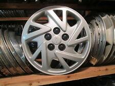 one genuine 2000 to 2005 Pontiac Sunfire hubcap wheel cover