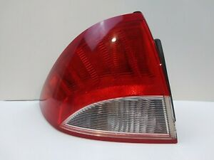 2010-2011 Mercury Milan Tail light Assembly left driver side used genuine Oem
