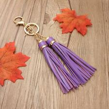 DOUBLE TASSEL BAG CHARM KEYRING GOLD PURPLE