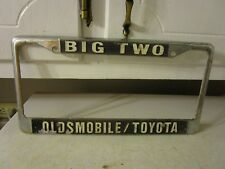 Vintage  ADVERTISING BIG TWO TOYOTA OLDSMOBILE LICENSE PLATE COVER ESTATE FIND