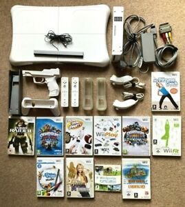 Nintendo Wii Bundle including Console, Games, Controllers, & Wii Fit Board