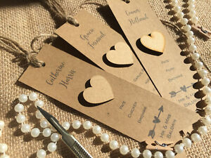 Place cards with menu choices and wooden heart. Wedding. Vintage. Bespoke. Twine