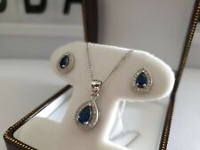 White gold finish sapphire and created diamond pearcut necklace and earrings