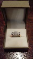 18ct gold diamond ring .78 points diamond rub over setting .16 diamonds..