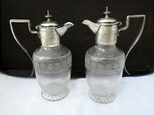 PAIR OF VICTORIAN CLARET JUGS LIQUOR JUGS SILVER PLATE AND GLASS