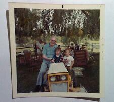 Vintage 70s PHOTO Grandpa w/ Two Nephews Sitting On Riding Lawnmower At Reunion