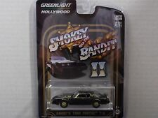GREENLIGHT HOLLYWOOD HITS BANDIT'S 1980 PONTIAC T/A IN BLACK & GOLD 1:64 SCALE