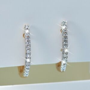 18k yellow gold slim huggies made with Swarovski crystal earrings simple classic