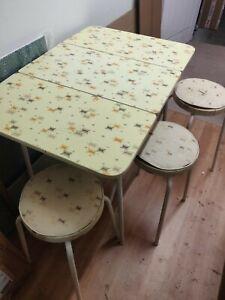 MID-CENTURY VINTAGE FORMICA DROP-LEAF TABLE AND THREE STOOLS