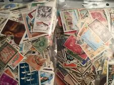 2000 plus world stamps off paper many good stamps and few mini sheets