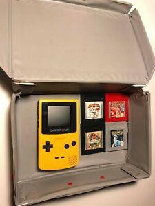 Game boy con giochi pokemon e nintendo box