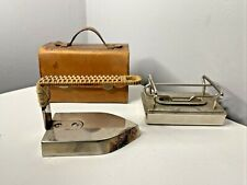 More details for rare vintage 1920s spirit heated travail iron in leather case in harrods book