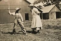 Real Photo RPPC ~ Woman Dressed As Man In Overalls Pretend Hits Woman In Apron