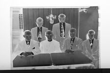 (1) B&W Press Photo Negative Group Men Vestment Sitting at Tables - T3347