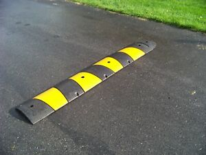 """Rubber speed bump, recycled rubber, 6 ft long X 12"""" wide 2.5"""" high."""