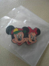 Disney's Mickey and Minnie Mouse head pin