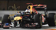 Sebastian Vettel SIGNED 12x8, F1 Red Bull R7 , Singapore GP  2011