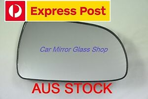 RIGHT DRIVER SIDE HOLDEN BARINA TK SEDAN 2006 - 2011 MIRROR GLASS WITH BASE