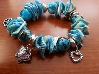 Silver tone beaded seashell blue silver charm stretch Bracelet