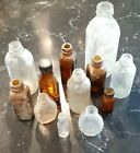 Lot of 12 Antique / Vtg Pharmacy Apothecary Bottles 1 has a cap various sizes