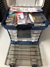 Fishing Lures And Tackle Box That Is Full Of Tackle
