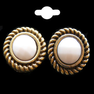 Round Stud Earrings Trimmed In An Antique Gold Colour Twisted Design