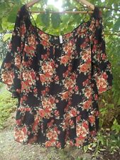 plus size peasant style top from Celeste floral on black polyester 2X