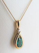 9CT GOLD TSAVORITE AND DIAMOND PENDANT AND 18'' CHAIN
