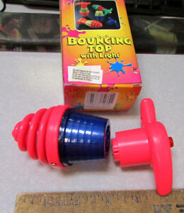 wind up spinning top, Pink plastic, crank top and hit button to release fun toy