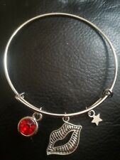 Expandable Silver Bangle With Lips, Star And Red Crystal