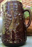 NORTH STAR STONEWARE PITCHER WITH GRAPES DESIGN DARK BROWN GLAZE