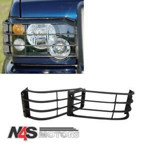 LAND ROVER DISCOVERY 2 FRONT LAMP GUARDS PAIR. PART- STC53193