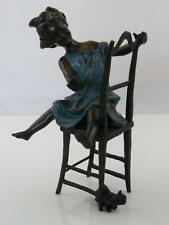COLD PAINTED BRONZE FIGURINE OF GIRL ON CHAIR WITH CAT