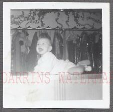 Vintage Snapshot Photo Cute Baby w/ Rack of Womens Clothes 687646