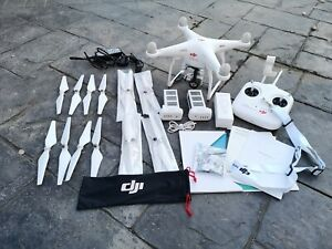 DJI Phantom 3 Standard (used), 2 batteries, 4 sets of blades, padded case.