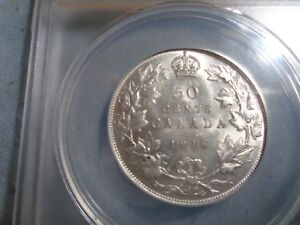 1918 canadian 50 cents au 55 graded by anacs, plus bonus coin.