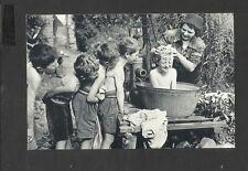 Nostalgia Postcard Evacuees chidren having a Scrub Down under the Pump 1941