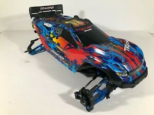 Used Traxxas Rustler 4x4 VXL Slider/Roller, Has Upgrades! and Body Included