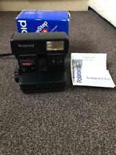 Un paso Polaroid flash cámara En Caja