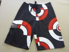 037 BOYS EX-COND RIP CURL CIRCLE WORK BLK / RED / WHITE BOARDSHORTS 12 $70 RRP.