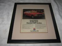 A Vintage Glass Covered Framed Genuine 1973 Advertisement Datsun 120Y
