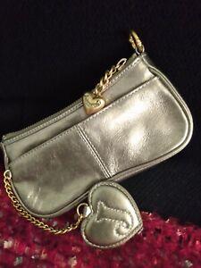Rare - Good condition Juicy couture-Mini wristlet gold'