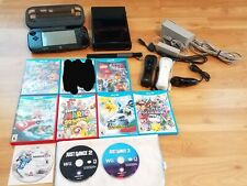 Nintendo Wii U Deluxe Video Game System Bundle with Games & Controllers